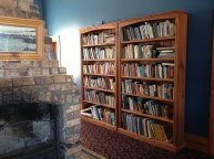 Old bookself and fireplace.