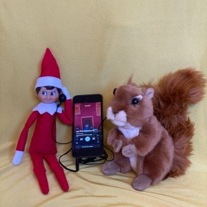 Elf and squirrel listening to music on headphones.