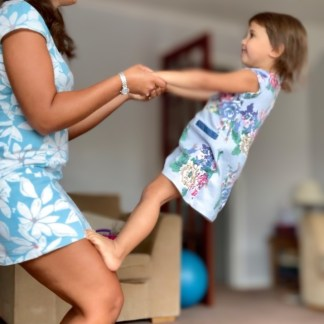mother and child performing a counterbalance representing growth