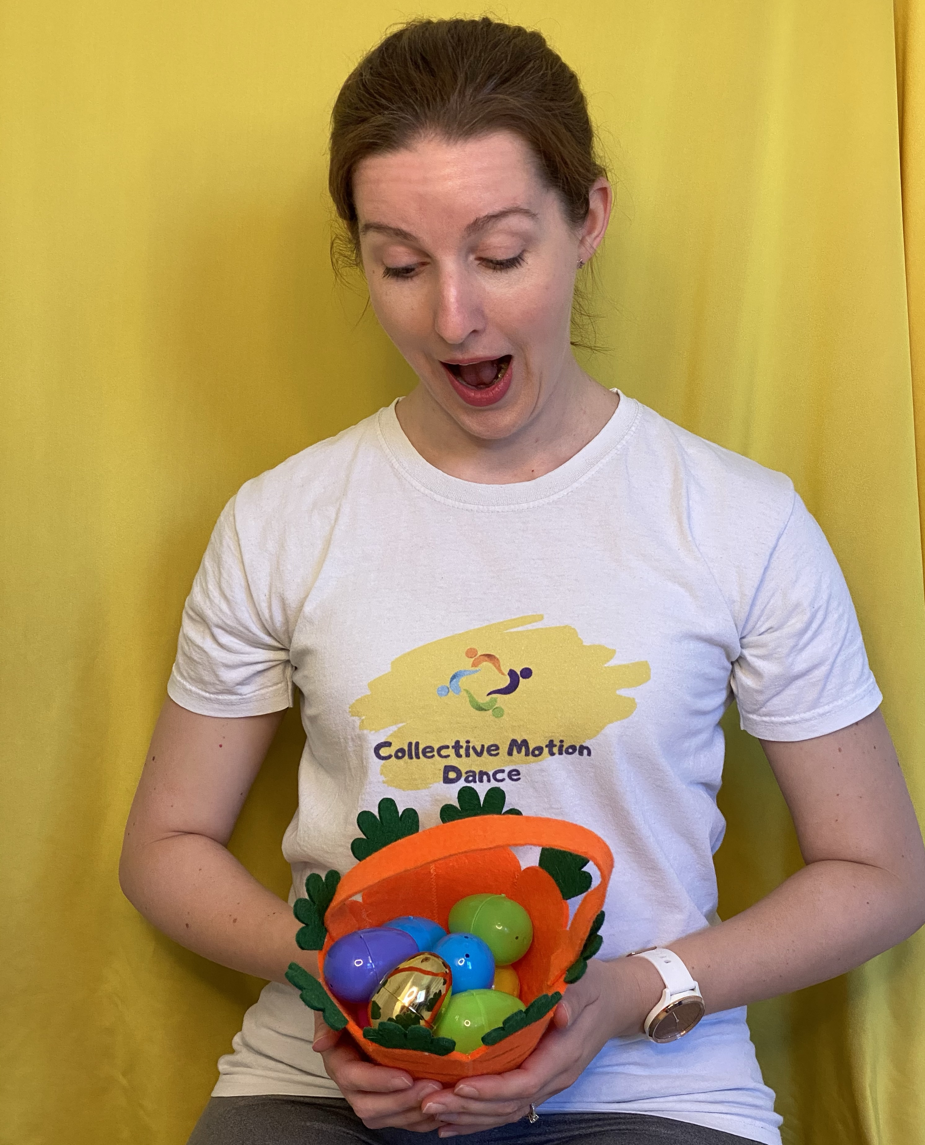 Woman with a basket of colourful plastic eggs.