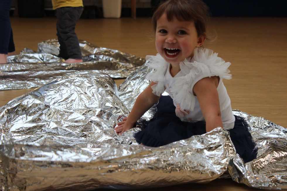 toddler on a foil blanket