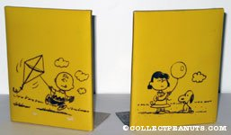 Charlie Brown flying kite & Lucy holding balloon with Snoopy Bookends