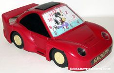 Snoopy driving red sports car Alarm Clock