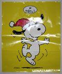 Snoopy dancing wearing red Santa hat