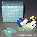 Snoopy laying on hill with Woodstock Figurine