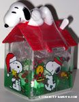 Snoopy laying on Christmas Scene doghouse Candy Container