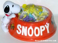 Snoopy with orange Easter decorated dogdish Candy Container