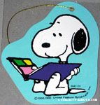 Snoopy looking through scrapbook Gift Tag