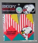 Snoopy holding gift