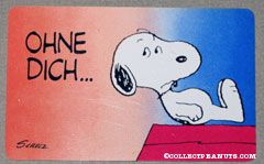 Snoopy laying on doghouse 'Ohne diche... sieht die welt so leer aus.' Wallet Greeting Card