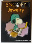 Snoopy in hockey gear on bench Pin