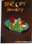 Snoopy & Character high-fiving in football helmets Pin