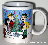 Peanuts gang singing around decorated Christmas Tree Mug