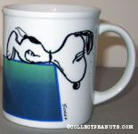 Snoopy leaning over doghouse Mug