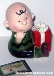 Charlie Brown holding Christmas Gift Music box