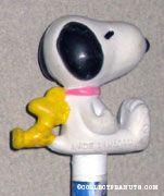 Snoopy and Woodstock leaning against each other Pencil Topper & Eraser