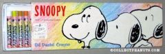 Snoopy heads on Crayon drawn background Oil Pastel Crayons set