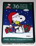 Snoopy holding gift boxes and Woodstock Box of Assorted Cards