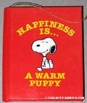 Snoopy 'Happiness is a Warm Puppy' Book Ornament