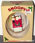 Snoopy on doghouse decorated with wreath Ornament
