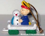 Linus building Snowman train car Ornament