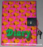 Orange Snoopys sitting on pink background Diary