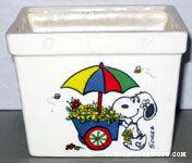 Snoopy pushing flower cart Planter