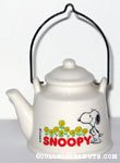 Snoopy looking at flowers Kettle-shaped Planter