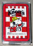 Snoopy wearing hat throwing cards over shoulder - Knott's Berry Farm Playing Cards