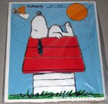 Woodstock delivering letter to Snoopy on doghouse Puzzle