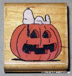Snoopy lying on pumpkin Rubber Stamp