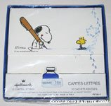 Snoopy with over-sized pen and Woodstock Stationery