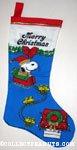 Santa Snoopy with sleigh drawn by Woodstocks Christmas Stocking