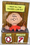 Charlie Brown in dugout box 'I need all the friendsI can get' Doll