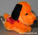 Orange Snoopy laying on tummy Stuffed Animal