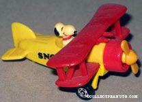 Snoopy pilot in red & yellow bi-plane