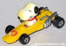 Snoopy in yellow race car