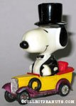 Large Snoopy in Tux driving yellow and purple car