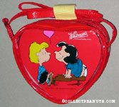 Lucy smiling at Schroeder on top of his piano Valentine's Heart-shaped Candy Box in Purse
