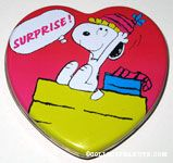 Snoopy wearing party hat 'Surprise' heart-shaped Tin