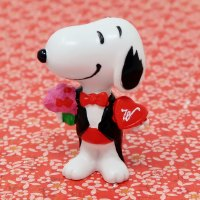 Snoopy wearing tuxedo holding flowers and candy Valentine