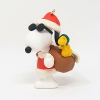 Joe Cool as Santa with Woodstock in bag Ornament