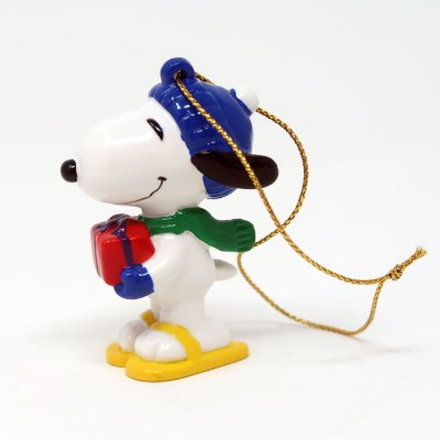 Snoopy holding present and wearing snowshoes Ornament