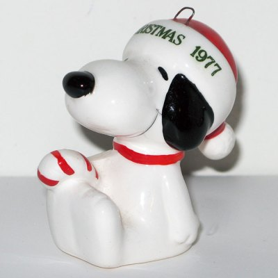 Snoopy sitting holding candy cane dated 1977 Christmas Ornament