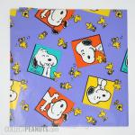 Snoopy and Woodstock laughing in squares wrapping paper sheet