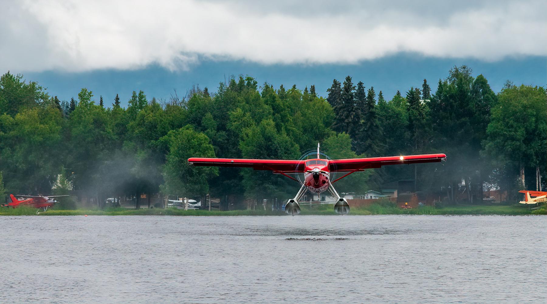 Red Alaskan sea plane takes off