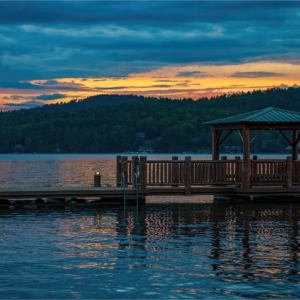 Gazebo at end of pier at sunset on Fourth Lake in Adirondacks, New York