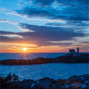 Beautiful winter sunrise at the Nubble Lighthouse along the coast of Maine