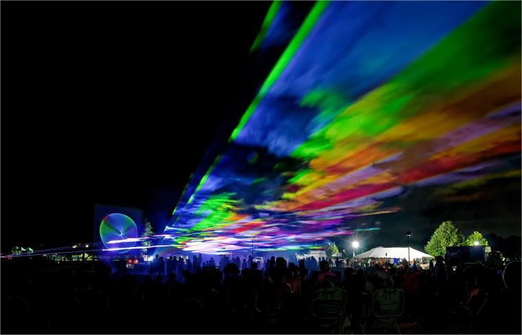 Laser show in the park lights up the summer sky