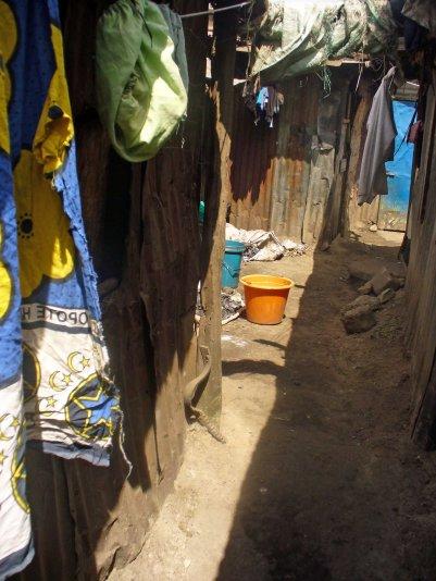 Corridor between Mathare homes, (c) Colleen Briggs